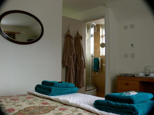A bed or beds in a room at 3 Corners B&B