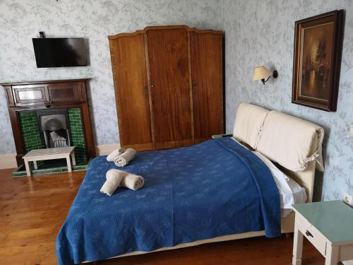 Кровать или кровати в номере Villa Melina