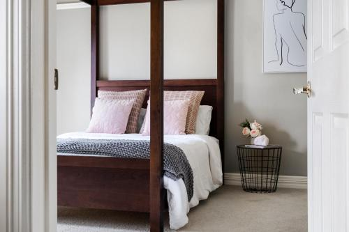 A bed or beds in a room at The Spa Cottage