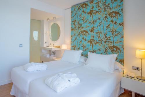 Ein Bett oder Betten in einem Zimmer der Unterkunft HM Gran Fiesta