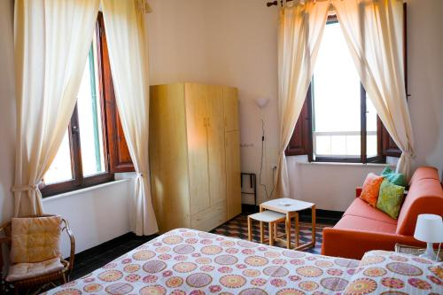 Кровать или кровати в номере Albergo Pensione Bartoli