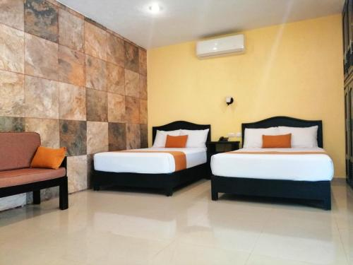 A bed or beds in a room at Departamentos X`Kanlol