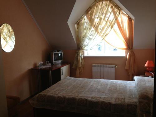 Кровать или кровати в номере Отель Наталья