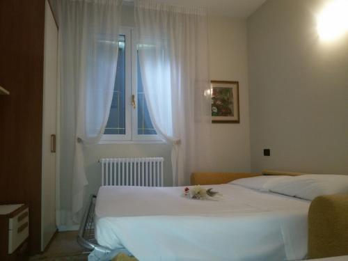 Letto o letti in una camera di Hotel Bruna
