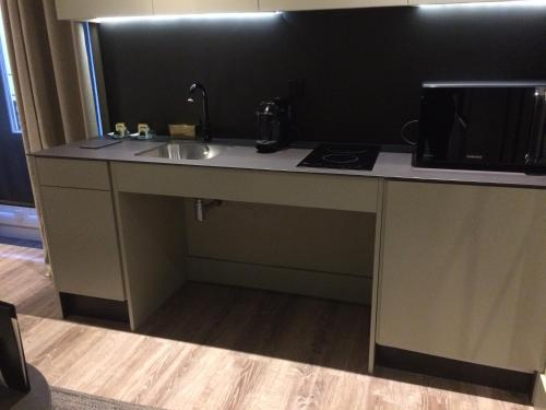 A kitchen or kitchenette at Cathedral Suites Hotel
