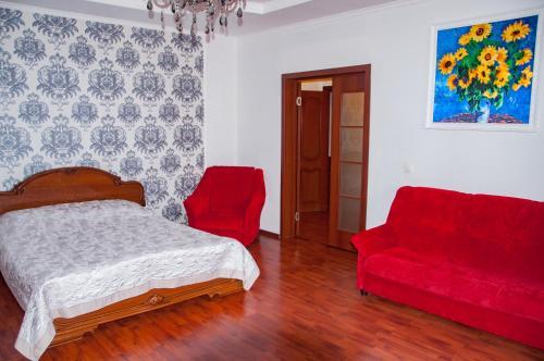 Кровать или кровати в номере Центральные апартаменты у Жемчужины