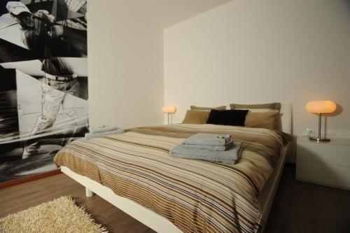 Кровать или кровати в номере Black Bridge Hotel Apartment