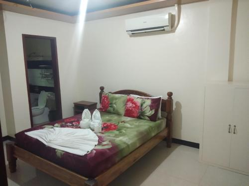 A bed or beds in a room at Buena's Haven Travelodge