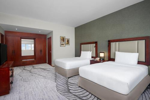 A bed or beds in a room at DoubleTree by Hilton Ras Al Khaimah