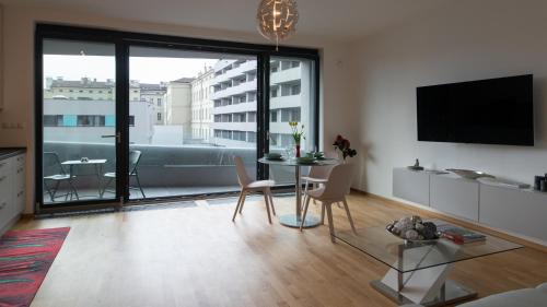 A television and/or entertainment center at Cozy apartment with terrace