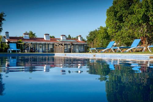 The swimming pool at or near Monte Da Galrixa