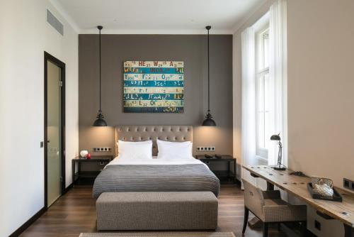 Ein Bett oder Betten in einem Zimmer der Unterkunft Quentin Prague Hotel