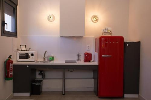 Una cocina o zona de cocina en TRIA NOMINA Apartamentos Turísticos