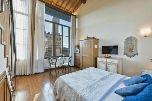 Cama o camas de una habitación en Palazzo Uguccioni Apartments