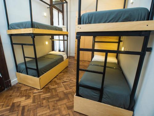A bunk bed or bunk beds in a room at Milhouse Avenue