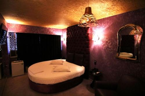 Кровать или кровати в номере The Crystal Blue Hotel