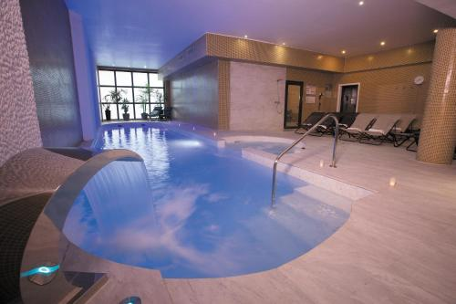 The swimming pool at or close to Eden Hotel & Spa