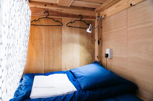 A bed or beds in a room at Uzu House