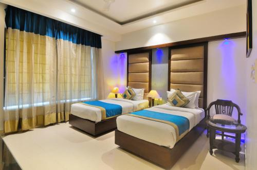 Un ou plusieurs lits dans un hébergement de l'établissement The Pearl Hotel