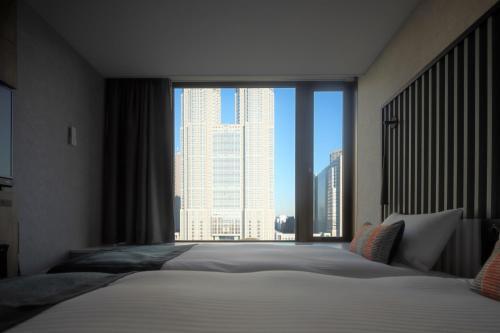 Cama o camas de una habitación en THE KNOT TOKYO Shinjuku
