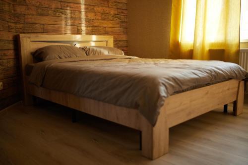 Кровать или кровати в номере Усадьба Выкопань
