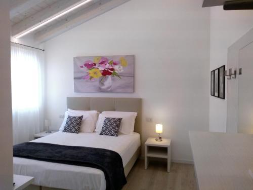 Letto o letti in una camera di Le Mandragole B&B