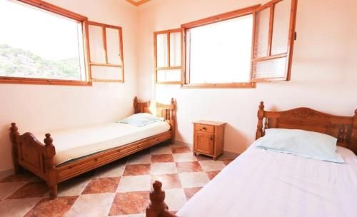A bed or beds in a room at Ocean's Spirit Apartment House Taghazout