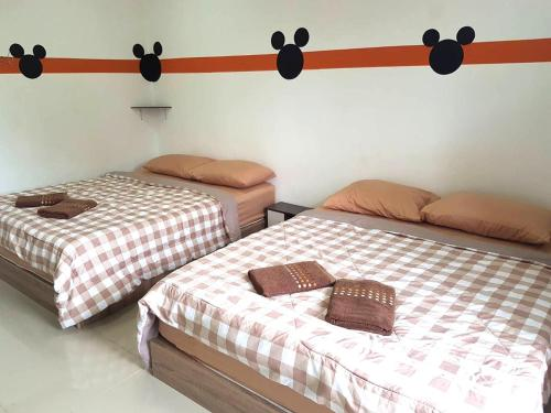 A bed or beds in a room at Mickey House