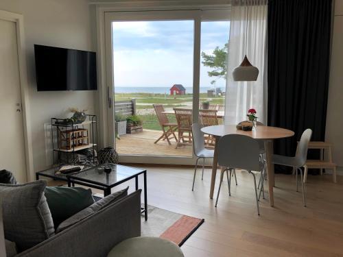 Oleskelutila majoituspaikassa Superfint boende med havsutsikt, Tofta Strand