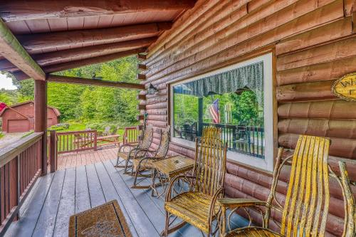 A balcony or terrace at Irresistible Schroon River Front Log Cabin