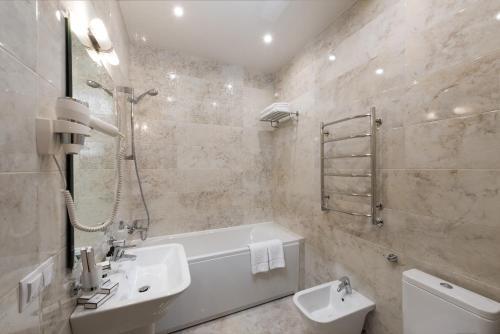 Ванная комната в Бутик отель Столица