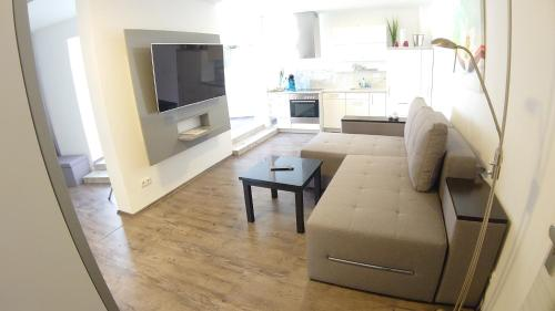 Ein Sitzbereich in der Unterkunft Ferienwohnung Siebenstern Jena
