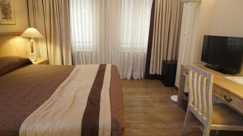 Cama o camas de una habitación en Hotel Diego de Almagro Santiago Centro