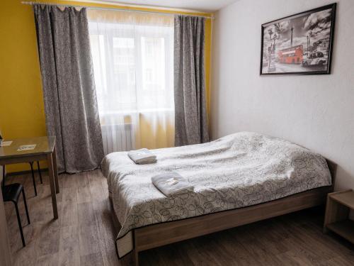 Кровать или кровати в номере Гостиница Кинолента