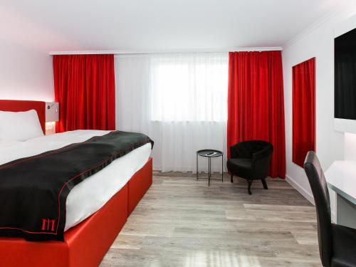 A bed or beds in a room at DORMERO Hotel Zürich Airport