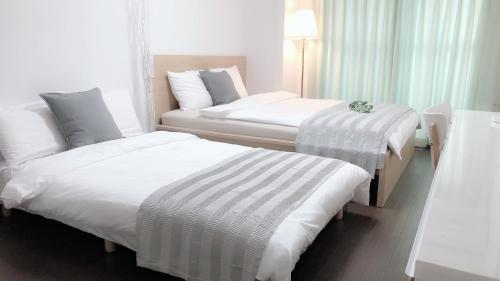 A bed or beds in a room at YUNA Guest house