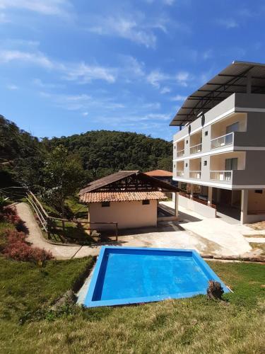 The swimming pool at or near Recanto da Tilapia