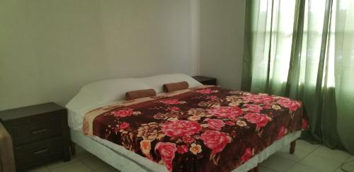 A bed or beds in a room at Amaryllis Hotel by Gooseberry