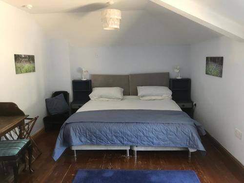 A bed or beds in a room at Pleck Barn