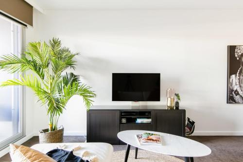 A television and/or entertainment center at ★Lux 2BR on Hindmarsh SQ★