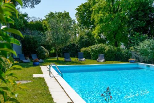 The swimming pool at or near Le Castel du Mont Boisé