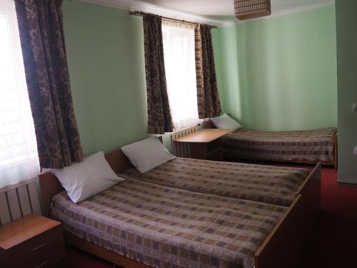 Кровать или кровати в номере Звездный