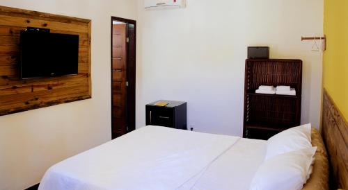 A bed or beds in a room at Pousada Stella Tropical