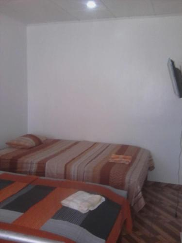 A bed or beds in a room at Residencia Marquiza