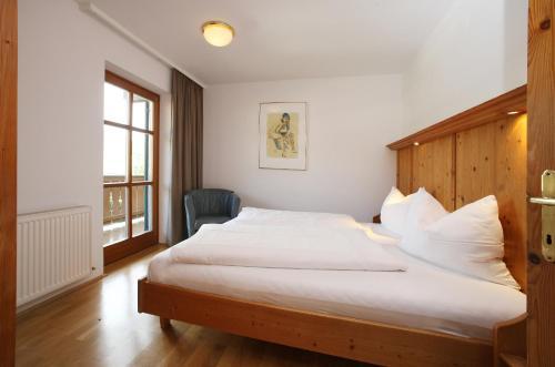 Ein Bett oder Betten in einem Zimmer der Unterkunft Agricola Villenwohnungen