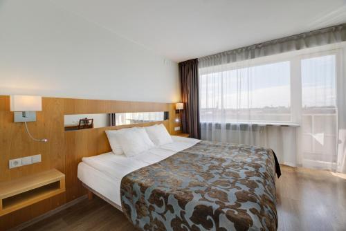 Voodi või voodid majutusasutuse Pärnu Hotel toas