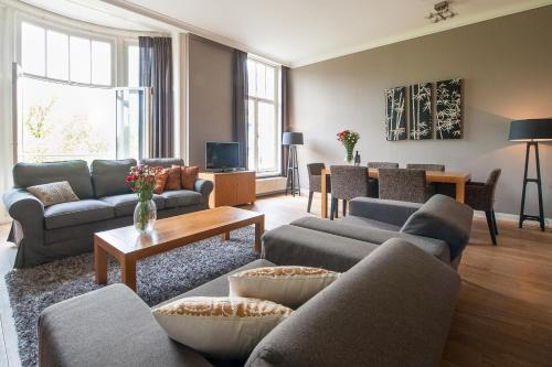 A seating area at Short Stay Group Leidseplein Luxury Serviced Apartments Amsterdam