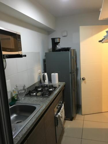 A kitchen or kitchenette at Andean Appartement