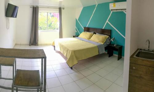 Cama ou camas em um quarto em Doña Clara vacation apartments