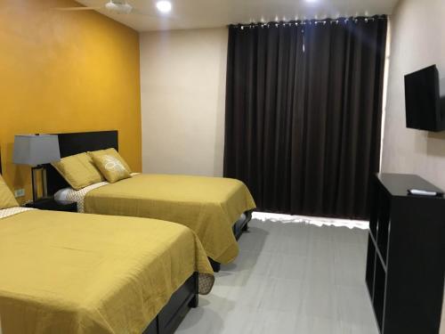 Кровать или кровати в номере Hotel Avila